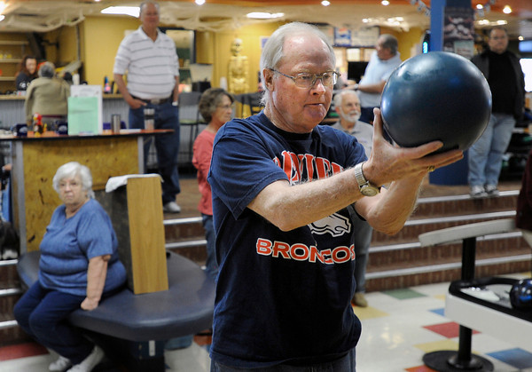 """Bill Adkins, 74, aims the ball down the lane during a senior bowling league on Monday, Oct. 15, at Chipper Lanes in Broomfield. For more photos and video of the bowling league go to  <a href=""""http://www.dailycamera.com"""">http://www.dailycamera.com</a><br />  Jeremy Papasso/ Camera"""