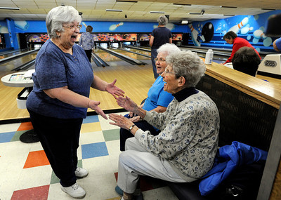 Martha Neish, 81, left, celebrates a strike with Evelyn Kanost, 79, and Mary Alice Bissell, 91, during a senior bowling league on Monday, Oct. 15, at Chipper Lanes in Broomfield. For more photos and video of the bowling league go to www.dailycamera.com  Jeremy Papasso/ Camera