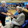 "Martha Neish, 81, left, celebrates a strike with Evelyn Kanost, 79, and Mary Alice Bissell, 91, during a senior bowling league on Monday, Oct. 15, at Chipper Lanes in Broomfield. For more photos and video of the bowling league go to  <a href=""http://www.dailycamera.com"">http://www.dailycamera.com</a><br />  Jeremy Papasso/ Camera"