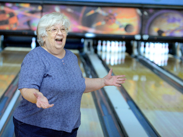 """Martha Neish, 81, of Broomfield, celebrates a spare during a senior bowling league on Monday, Oct. 15, at Chipper Lanes in Broomfield. For more photos and video of the bowling league go to  <a href=""""http://www.dailycamera.com"""">http://www.dailycamera.com</a><br />  Jeremy Papasso/ Camera"""