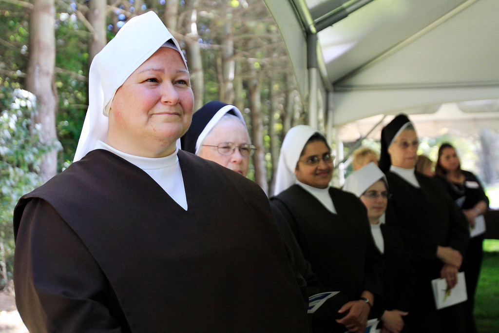 . Carmelite nuns attend a press conference announcing the sale of the Providence Care Center from the Sisters of Providence Health System to the Carmelite Sisters at the facility in Lenox. Monday, September 30, 2013. Stephanie Zollshan/Berkshire Eagle Staff.