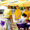 Tom Rushworth, at left, checks in with Hugh Breen and Tara Worthley Saturday, Sept. 7, at the Lions Club tent during Fall Festival. The Zionsville Lions Club sponsors the festival, and Worthley, Breen and Rushworth are among the many Lions members who help make it possible.