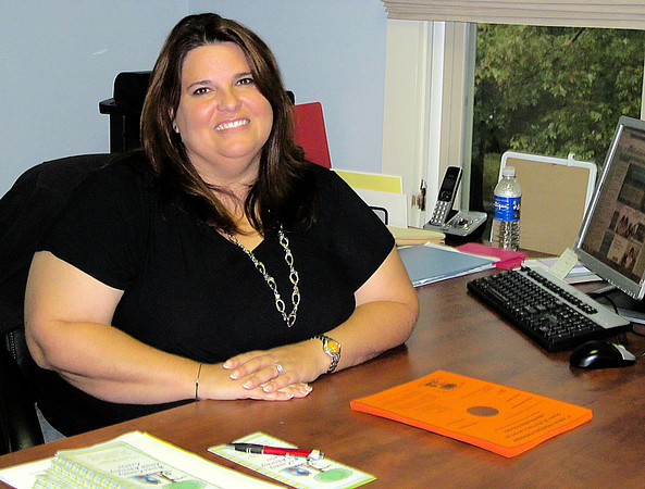Reporter photo by Rod Rose<br /> Kassie Frazier in her office at the Boone County Child Advocacy Center.