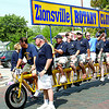 Zionsville Rotarians ride a bicycle made for ... 10?! The organization entered the bike in the 2013 Zionsville Fall Festival parade.