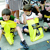 Drake Seach, 6, at left, checks out the goodies in his bag at the 2013 Fall Festival parade as Luca Ranalli, 6, center, and Maxwell Seach, 5, at right, wait to hear what he got. The boys are the sons of Brett and Melissa Seach and Dean and Jennifer Ranalli, all of Zionsville.