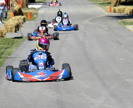 Southern Indiana Racing Association drivers round a curve Saturday afternoon, Sept. 14, during the Whitestown Grand Prix.