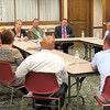 Senator Joe Donnelly speaks with local business leaders during a luncheon.