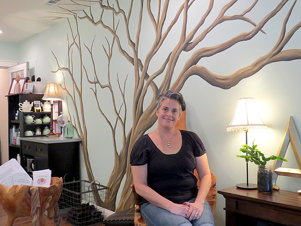 Ansatz Owner poses in her new studio.