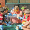 STEM SCOUTS<br /> Elizabeth Pearl | The Lebanon Reporter<br /> STEM Scouts students at Hattie B. Stokes Elementary School put together hydroponic garden tanks on Thursday in the school courtyard.