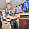 "C-SPAN IN ZIONSVILLE<br /> Elizabeth Pearl | The Lebanon Reporter<br /> ROTARIAN TOUR: Zionsville Rotary Club President Marc Mitalski, along with other Rotarians, was shown around the C-SPAN tour bus on Thursday morning at Zionsville High School. The bus is on the road 11 months out of the year, following candidates and campaign trails. It stopped to visit the club and give its members a tour before making its way to cover the presidential debates later this month. The bus is equipped with a seating area where live broadcasts and prerecorded interviews are filmed. <br /> ""They use the bus as an education tool,"" Mitalski said. ""They talked about their perspective on how they cover politics. It was pretty interesting."""