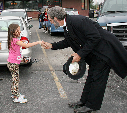 Rod Rose The Lebanon Reporter<br /> DELIGHTED TO MEET YOU: Audrea White, 7, Lebanon, was among about 50 people who greeted President Abraham Lincoln when he arrived in Lebanon Saturday morning, at the site of a former railroad track where the orignal president paused in 1860 on his way to Washington, D.C.