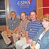 "C-SPAN IN ZIONSVILLE<br /> Elizabeth Pearl | The Lebanon Reporter<br /> ROTARIAN TOUR: Zionsville Rotary Club President Marc Mitalski (far left), club directors Ron Martin and Andrew Liss, and treasurer Amy Smith were shown around the C-SPAN tour bus on Thursday morning at Zionsville High School. The bus is on the road 11 months out of the year, following candidates and campaign trails. It stopped to visit the club and give its members a tour before making its way to cover the presidential debates later this month. The club members are seated where C-SPAN's interviews are broadcasted live or recorded. <br /> ""They use the bus as an education tool,"" Mitalski said. ""They talked about their perspective on how they cover politics. It was pretty interesting."""