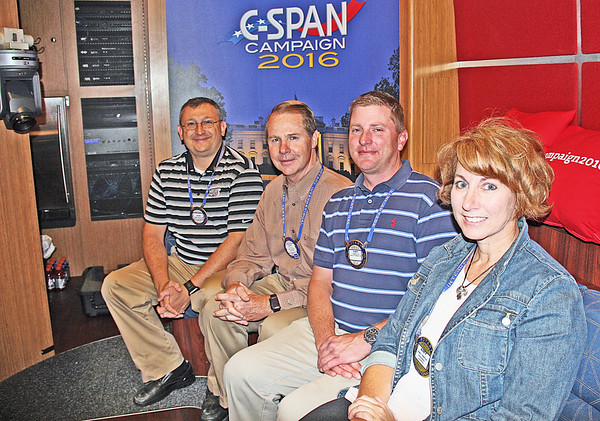 "C-SPAN IN ZIONSVILLE Elizabeth Pearl | The Lebanon Reporter ROTARIAN TOUR: Zionsville Rotary Club President Marc Mitalski (far left), club directors Ron Martin and Andrew Liss, and treasurer Amy Smith were shown around the C-SPAN tour bus on Thursday morning at Zionsville High School. The bus is on the road 11 months out of the year, following candidates and campaign trails. It stopped to visit the club and give its members a tour before making its way to cover the presidential debates later this month. The club members are seated where C-SPAN's interviews are broadcasted live or recorded.  ""They use the bus as an education tool,"" Mitalski said. ""They talked about their perspective on how they cover politics. It was pretty interesting."""
