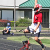 TRIKE TRIUMPH<br /> Elizabeth Pearl | The Lebanon Reporter<br /> THREE-WHEELED SUCCESS: Homecoming week at Lebanon High School opened this week with the annual 499+1 Trike Race at the football stadium. Shown above, a member of Teem Wolf celebrates their victory in the stock trike race on Monday afternoon. The homecoming festivities will continue through Friday. The events include the powder puff football game tonight at 7 p.m. and a parade on Friday at 5 p.m. The homecoming dance will take place in the LHS gym at 7:30 p.m. on Saturday.