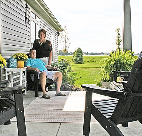 HOME TOUR: Judi and Albert Hendrix lounge on their back porch.
