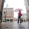 BEN GARVER — THE BERKSHIRE EAGLE<br /> A woman pauses in the rain on North Street in Pittsfield, Mass., Wednesday, September 12, 2018. The Northeast has has had several days of wet weather that is forecast to break by the weekend. (Ben Garver / The Berkshire Eagle via AP)