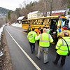 KRISTOPHER RADDER — BRATTLEBORO REFORMER<br /> First responders run through a check list of students on board the second bus before being transported to Leland & Gray Union Middle and High School on Wednesday, Nov. 28, 2018.