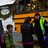 KRISTOPHER RADDER — BRATTLEBORO REFORMER<br /> Kristine Clark signs out her children Patrick, 15, Alex Mayotte, 15, and Ethan Mayotte, 10, after picking them up on at scene of a school bus crash on Route 30, in Townshend, Vt., on Wednesday, Nov. 28, 2018. No injuries were reported on scene.