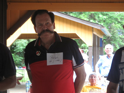 ELIZABETH DOBBINS / GAZETTE Ralph Smith, the winner of the longest mustache award, showed off his whiskers during the Brothers of the Brush contest.