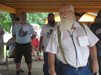 ELIZABETH DOBBINS / GAZETTE John Moore, 74, of Seville spins to show off his beard during the Brothers of the Brush facial hair contest.