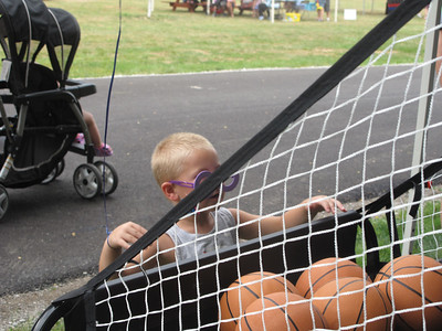 ELIZABETH DOBBINS / GAZETTE Jaxson Musser, 4, of Sterling Township, shoots hoops at the Village of Seville Bicentennial Celebration.