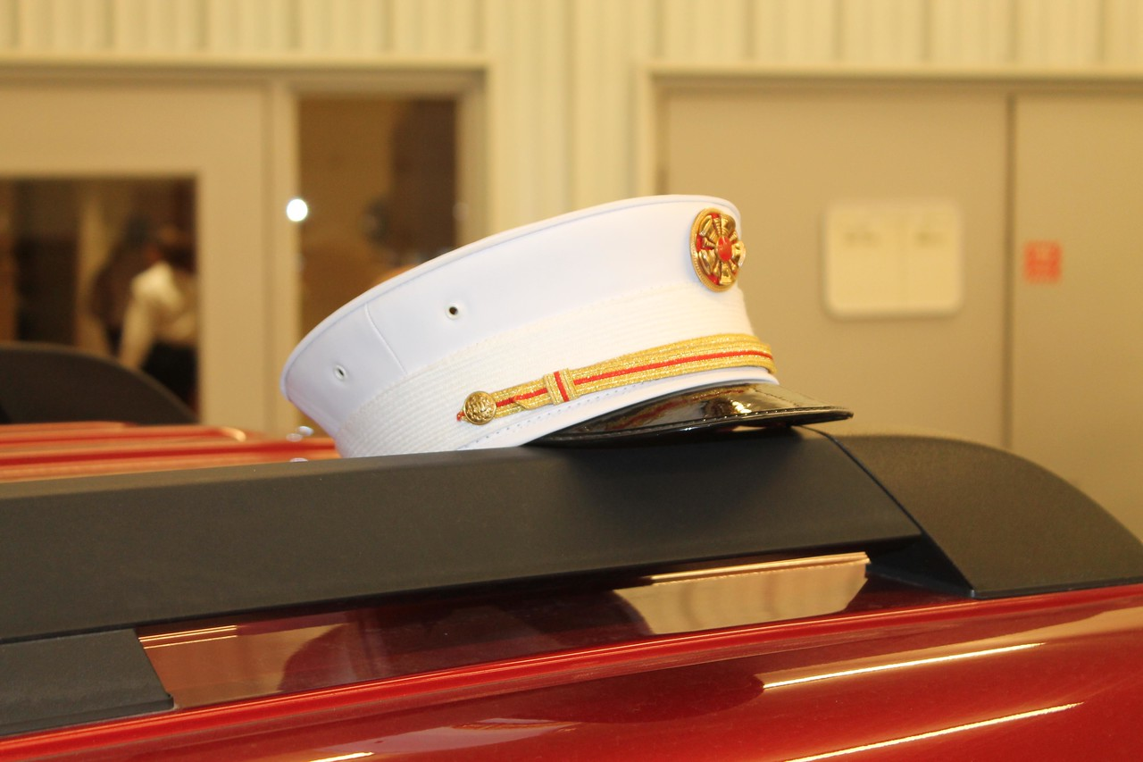 LAWRENCE PANTAGES / GAZETTE Seville Fire Chief Jerry Winkler wore his dress uniform to a ceremony honoring him Thursday for receiving Executive Fire Officer certification from the National Fire Academy. While he greeted well-wishers at the station, his formal hat rested atop a department vehicle.