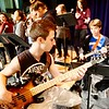 BEN GARVER — THE BERKSHIRE EAGLE <br /> Wahconah Regional High School band director Brian Rabuse and choir director Rebecca Hoffman lead the school band and choir in a rehearsal of Sgt. Pepper's Lonely Hearts Club Band, Tuesday, March 15, 2017.  The bass player is Wyatt Giansiracusa, 17, and the guitar player behind him is Jacob Borowsky.
