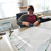 KRISTOPHER RADDER — BRATTLEBORO REFORMER<br /> Krista ES Coughlin-Galbraith, co-owner of Shapeshifters, uses an electric cutting device while cutting out a pattern in the spandex material for a chest binder on Wednesday, Dec. 12, 2018.