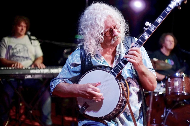 BEN GARVER — THE BERKSHIRE EAGLE<br /> Arlo Guthrie does a sound check before a Shenandoah Concert at the Guthrie Center in Great Barrington. Abe Guthrie and Terry A LA Berry are in the background.  Shenandoah, in various forms through the years, has been playing with Guthrie since 1975.