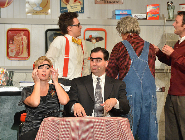 "Dianne McCoy and Mike McCoy playing the ""bad guys"" Irene Baby Face Malone and Maxamillian the Chameleon try on uni-brows during Saturday's performance of Hometown Memories a Shepard of Love Fellowship melodrama dinner theater production .<br /> August 11, 2012<br /> staff photo/ David R. Jennings"