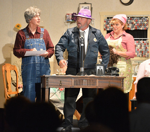 Jack Jaynes, center, playing Sgt. Dan Weatherbee, sells a product on Betty Jo's radio show with Art Cota, left, playing Clyde, and Shana Preisler, right, playing Betty Jo during Saturday's performance of Hometown Memories a Shepard of Love Fellowship melodrama dinner theater production .<br /> August 11, 2012<br /> staff photo/ David R. Jennings