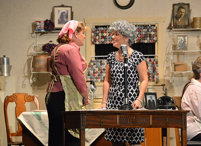 Shana Preisler, left, talks with Barb Homes, playing Norma Jean during Saturday's performance of Hometown Memories a Shepard of Love Fellowship melodrama dinner theater production . August 11, 2012 staff photo/ David R. Jennings