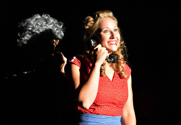 Grace Grein playing Pearly May, talks on the phone about her sweet heart, Jeb during Saturday's performance of Hometown Memories a Shepard of Love Fellowship melodrama dinner theater production .<br /> August 11, 2012<br /> staff photo/ David R. Jennings