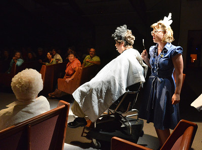 Elizabeth Huddle, right, playing Nadine, talks to Matt Martin, playing Emmett McElroy, while giving him a shave during Saturday's performance of Hometown Memories a Shepard of Love Fellowship melodrama dinner theater production . August 11, 2012 staff photo/ David R. Jennings