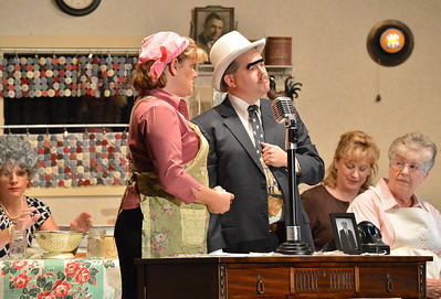 The hero and heroine Shana Preisler, left, playing Betty Jo, and Dave Kellett, playing Detective Walter McBride chat during Saturday's performance of Hometown Memories a Shepard of Love Fellowship melodrama dinner theater production . August 11, 2012 staff photo/ David R. Jennings