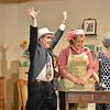 Dave Kellett, center, playing the hero Detective Walter McBride makes his entrance on stage with Shana Preisler, playing Betty Jo, center, and Barb Holmes, playing Norma Jeanduring Saturday's performance of Hometown Memories a Shepard of Love Fellowship melodrama dinner theater production .<br /> August 11, 2012<br /> staff photo/ David R. Jennings