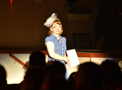 Elizabeth Huddle, playing Nadine, prepares to hold up a sign for the sudienceduring Saturday's performance of Hometown Memories a Shepard of Love Fellowship melodrama dinner theater production . August 11, 2012 staff photo/ David R. Jennings