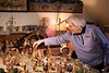 Shirley Squires, 88, points out her largest creche scene, made by the Italian maker Fontanini, which numbers in the hundreds and depicts an ancient village, surrounding the nativity; KELLY FLETCHER, REFORMER CORRESPONDENT
