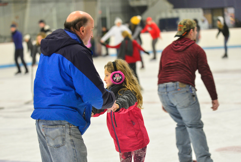 KRISTOPHER RADDER — BRATTLEBORO REFORMER<br /> Don LaFontaine helps his 8-year-old daughter, Alicia, to skate backwards at Nelson Withington Skating Facility during Last Night Brattleboro on Tuesday, Dec. 31, 2019.