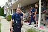 Members of a hazmat team talk to residents on North Gorski Lane in Skippack Township.   Monday,  July 14, 2014.   Photo by Geoff Patton