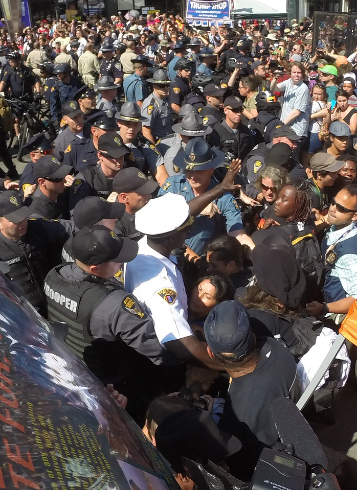 Cleveland police chief Calvin Williams in the white hat near the bottom of the photo waded into the crowd as police officers try to push back protesters and media in the biggest scuffle this week. Several arrests were made. BRUCE BISHOP/GAZETTE
