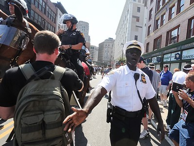 Cleveland police chief Calvin Willams clears the crowd as he brings in the horses to break up a protest that resulted in several arrests.  BRUCE BISHOP/GAZETTE