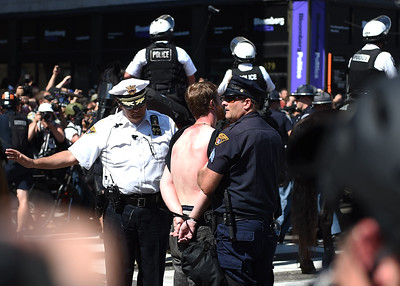 KRISTIN BAUER | GAZETTE Protestors from the RevCom group were arrested on Prospect Ave., in downtown Cleveland after they burned the American Flag and clashed with police.