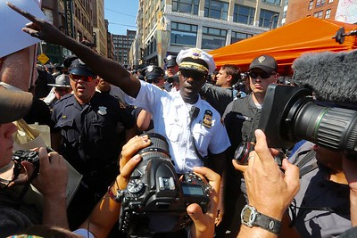 Cleveland police chief Calvin Williams orders the press and protesters out of the area as officers struggle to make arrests after a protest got out of control.  BRUCE BISHOP/GAZETTE