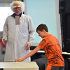 KRISTOPHER RADDER - BRATTLEBORO REFORMER<br /> Dr. Quinton Quark watches as he has a student at Academy School chop a piece of wood. The experience would later go to show the power of air when a piece of paper is placed on a selection of the wood.