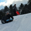 KRISTOPHER RADDER - BRATTLEBORO REFORMER<br /> Emma Paris, 11, of Putney, and Galen Fogarty, 11, of Brattleboro, sled down the hill.