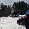 KRISTOPHER RADDER - BRATTLEBORO REFORMER<br /> Jude Paris, 8, of Putney, makes his move to crash into his older sister Emma, 11, while sledding.