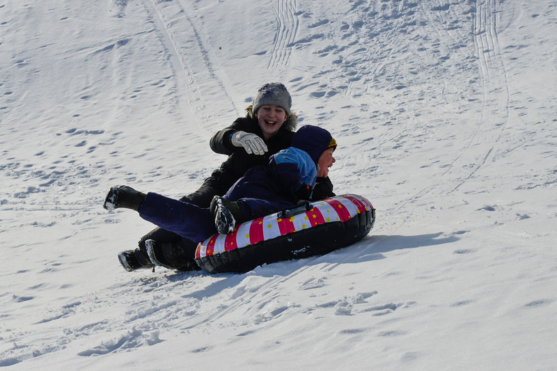 KRISTOPHER RADDER - BRATTLEBORO REFORMER<br /> Emma Paris, 11, of Putney, crashes into her little brother Jude, 8, while sledding at Living Memorial Park.