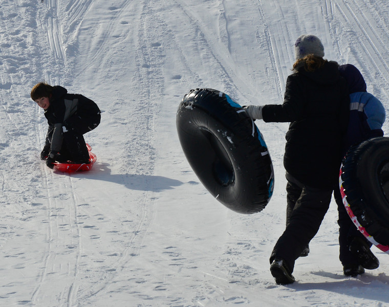 KRISTOPHER RADDER - BRATTLEBORO REFORMER<br /> Children enjoy the warm weather as they go sledding at Living Memorial Park on Tuesday, Jan. 9, 2018.