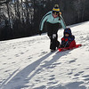 KRISTOPHER RADDER - BRATTLEBORO REFORMER<br /> Children enjoy the warm weather as they go sledding at Living Memorial Park on Tuesday, Jan. 9, 2018.